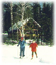 Skiers in front of cabin